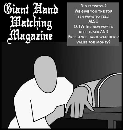 Giant Hand Watching Magazine!